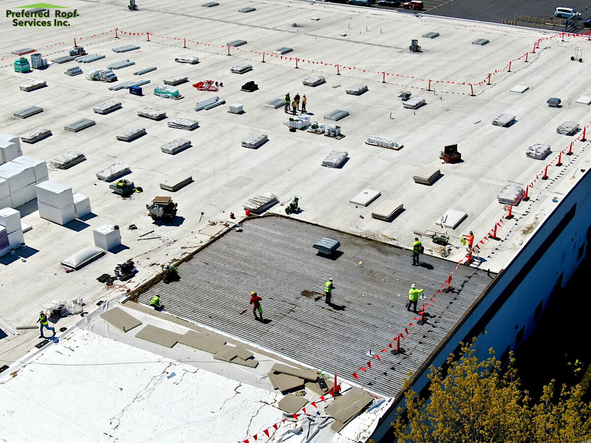 In-progress of tear-off and installation for Port of Tacoma in Tacoma, Wa.