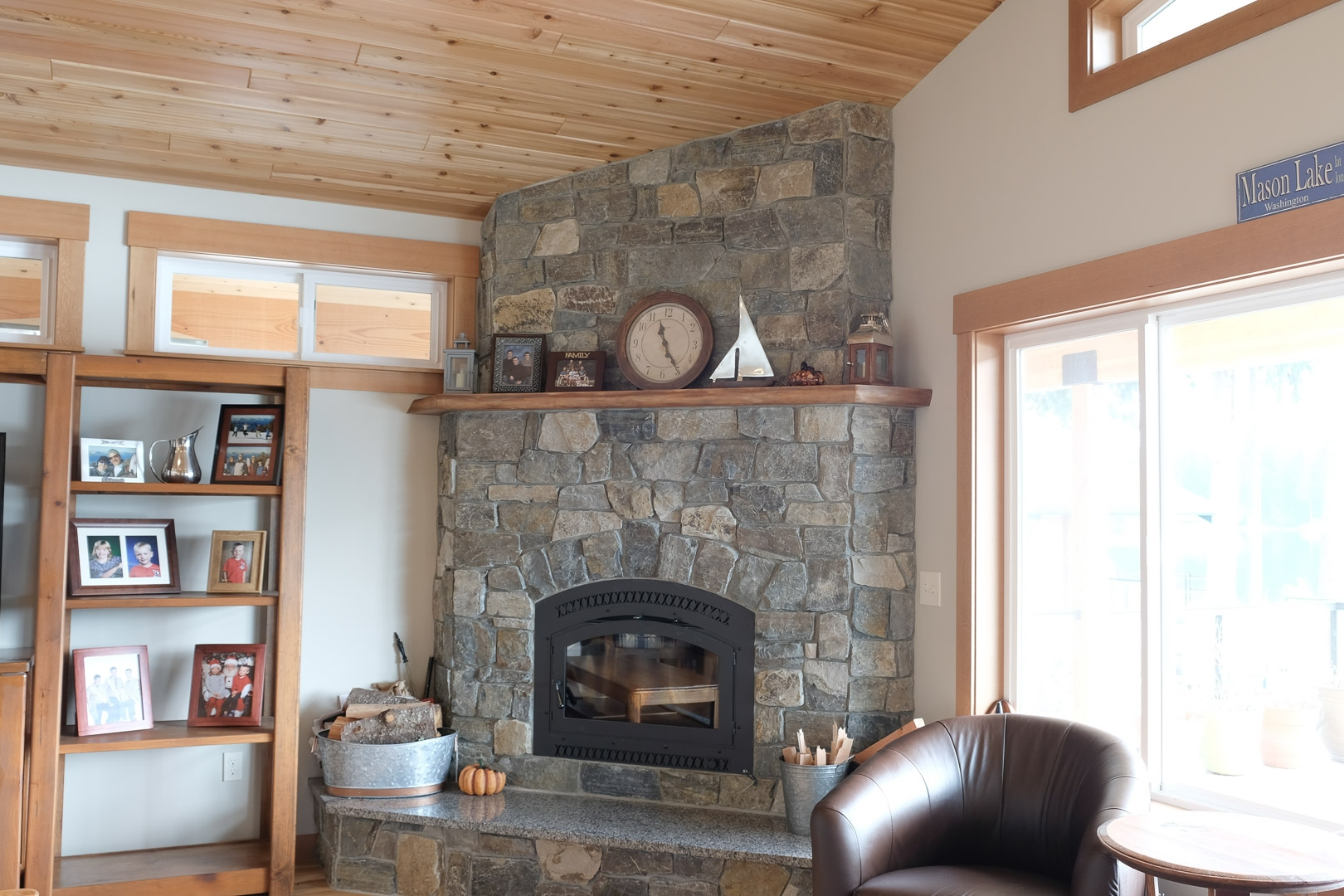Corner Wood Burning Fireplace with Stone Face, Raised Hearth and Wood Mantle