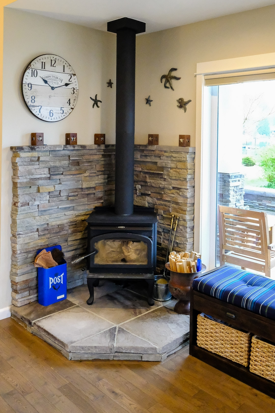 Freestanding Wood Fireplace with Stone Back walls & Slate Base