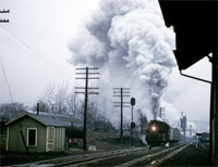 FEBRUARY - Conneaut, Ohio, could be a dreary place during a Lake Erie Winter, and February 26, 1957, was no exception. S-3 Berk Number 772 approaches eastbound, trailing 86 cars under a gorgeous plume of smoke and steam. - D.R. McCulloch photo,  Thos Gascoigne collection