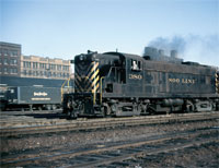 "MARCH - Apparently those Nickel Plate Road trailers could and did get around, as witnessed in this scene in the Northern Pacific yard at 2nd Street in Minneapolis, Minn It seems like black and yellow was still the ""in"" color scheme back in March 1963. - Thos Gascoigne collection"