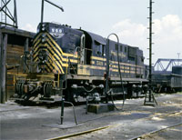 APRIL - Alco 569 reposes, in all its multi-striped glory, in the NKP's Abbott Road engine terminal in Buffalo, N.Y., in May 1966. - Thos Gascoigne collection