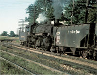 SEPTEMBER - Here we have an NKP 2-8-2 flying Extra flags while drilling hopper cars at Bellevue, Ohio, in September 1957. - Thos Gascoigne collection
