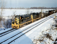 DECEMBER - On December 19, 1974, D&TS 43 and 46 are leading 63 cars westbound at Stanley Tower on the Toledo Terminal Railroad, another NKP affiliate. - D.R. McCulloch photo, Thos Gascoigne collection