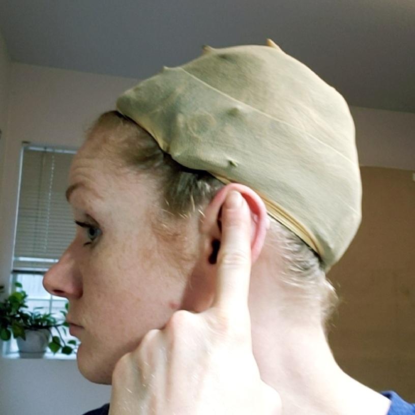 L Center Top of Ear Across Back