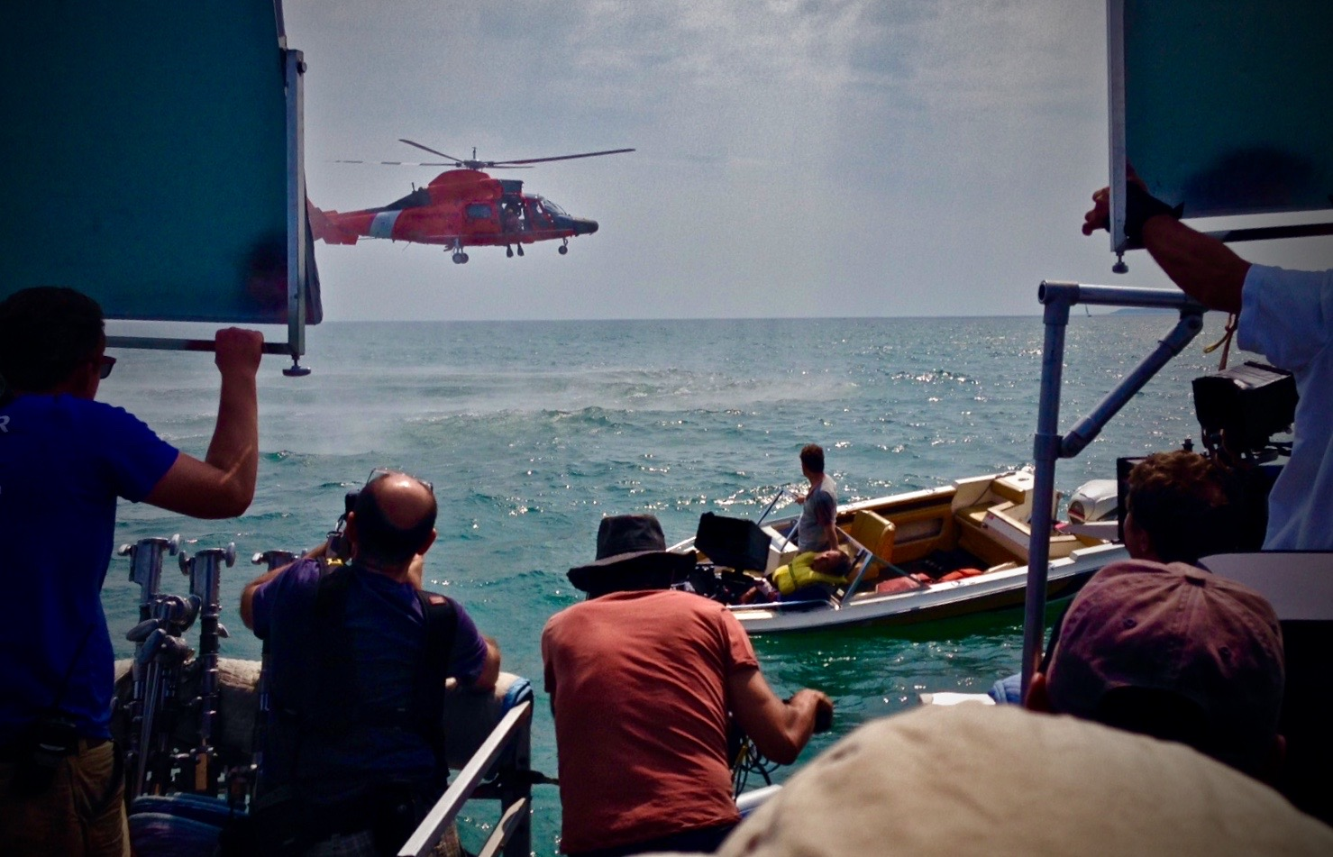 "JIMMY SAMMARCO, (CENTER) ON CAMERA, FILMING A COAST GUARD RESCUE SCENE FOR ""THE SURFACE"""