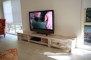 Casual understated yet chic this entertainment unit enhances its surrounds.