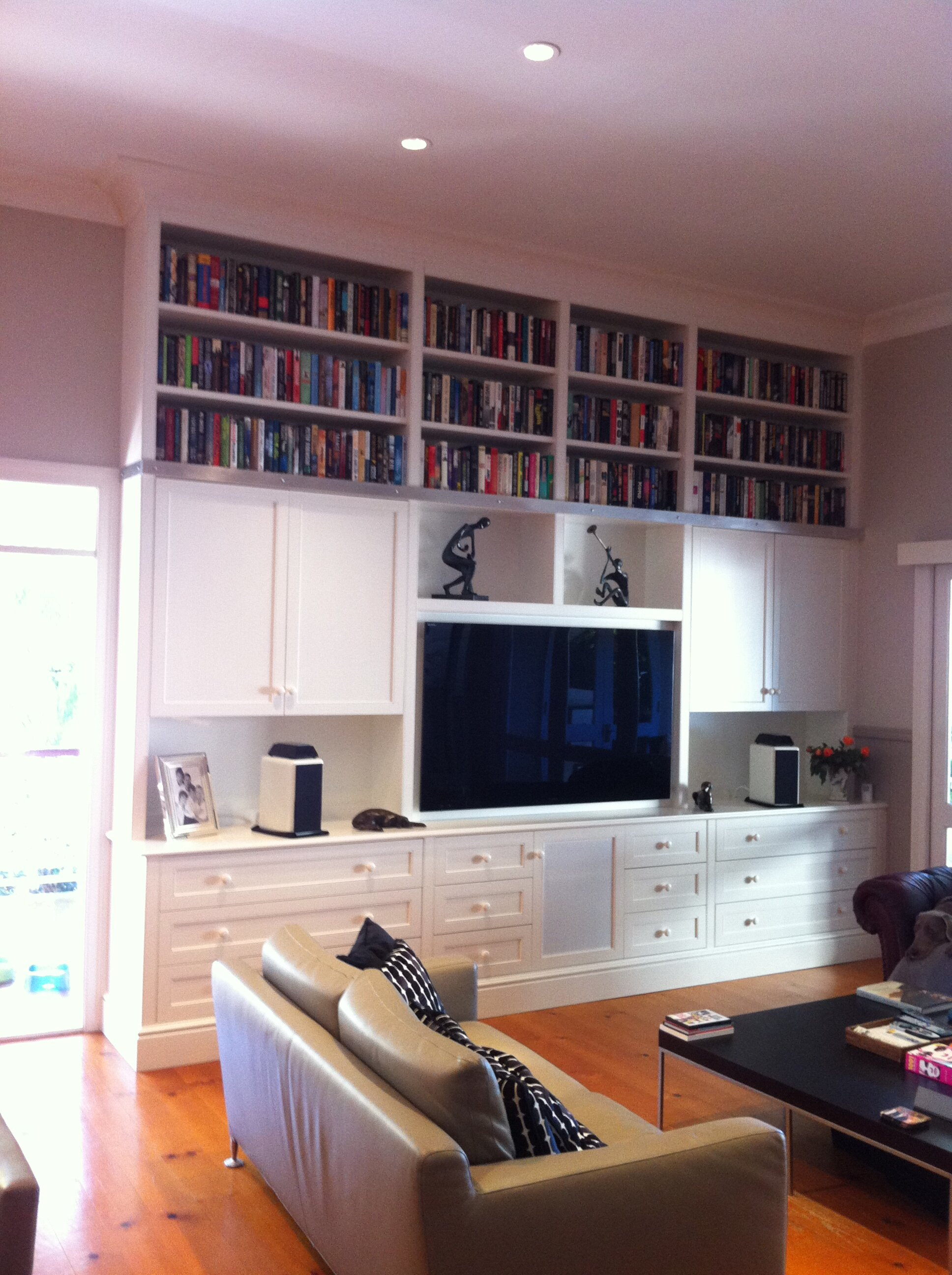 White gloss bookcase, providing a wonderful distinction between wall and floor