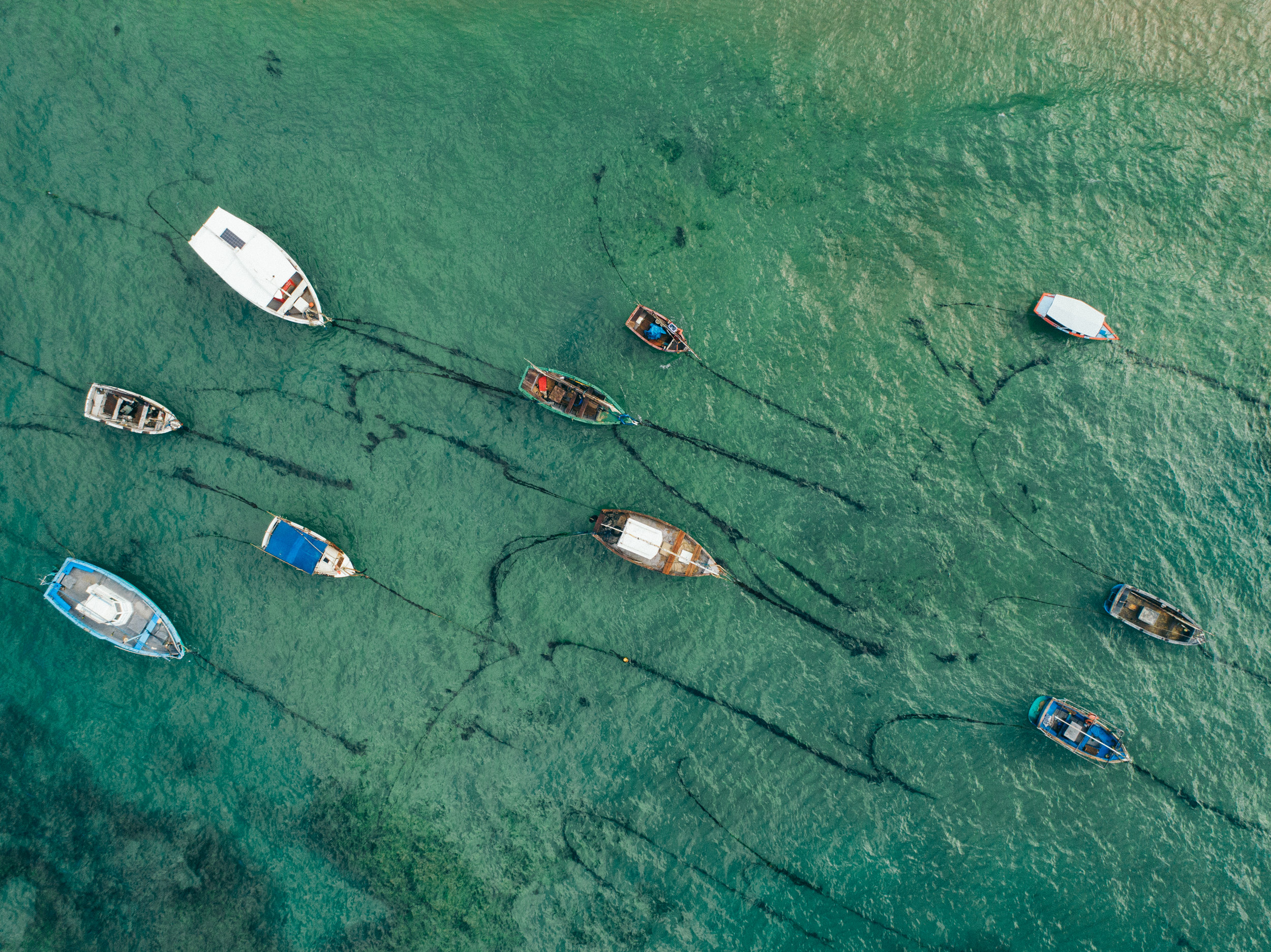 Drone view of fishing boats in Itacaré, where ETIV do Brasil - Volunteer in Brazil is located