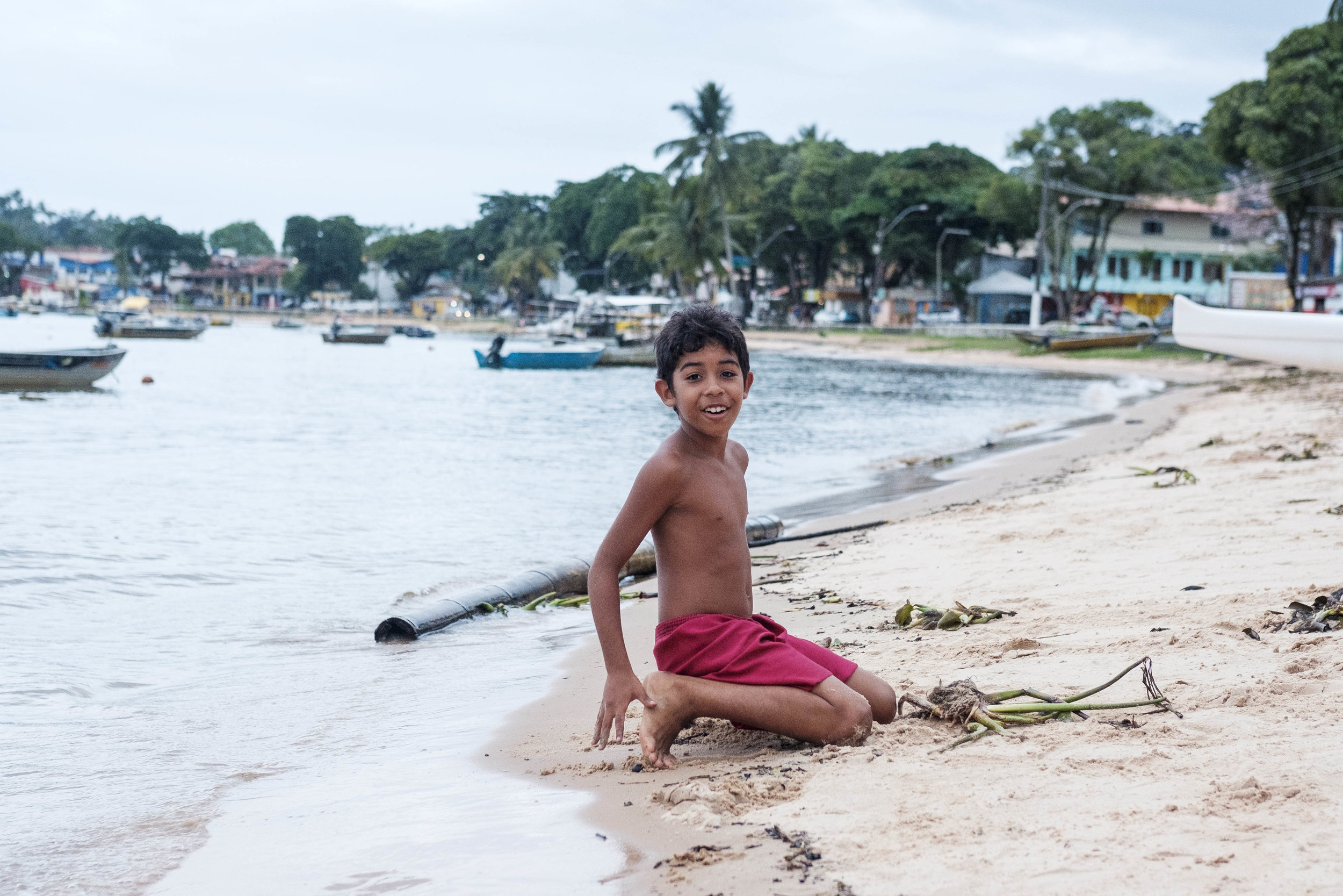 Portrait of a local boy at the beach in Itacaré, Bahia, Brazil