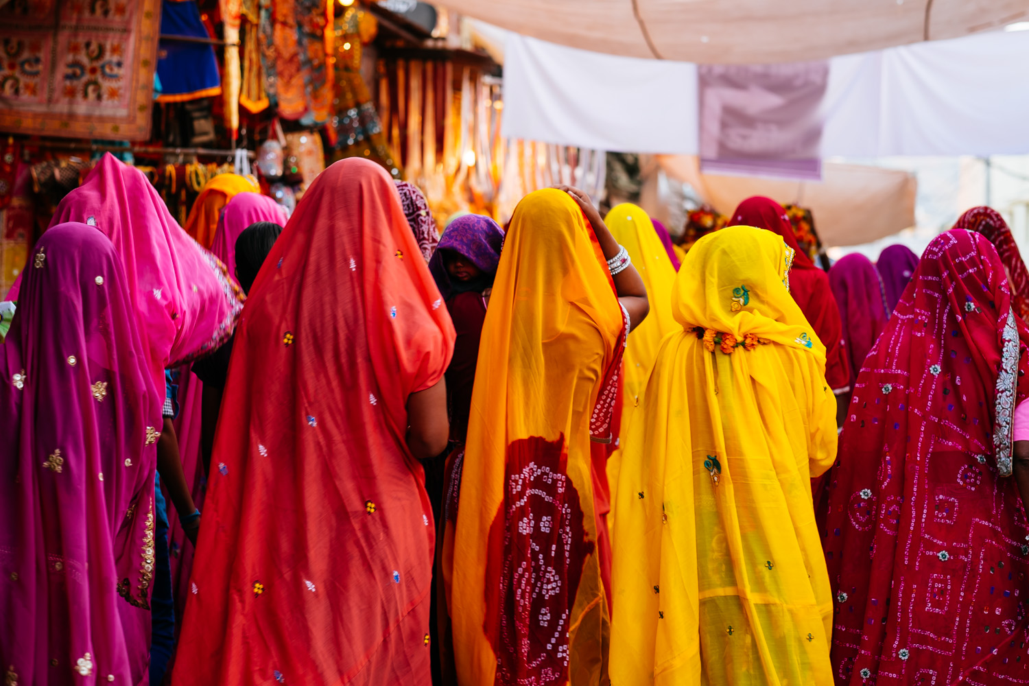 Wearing traditional clothes, women walk through the streets of Pushkar, India.