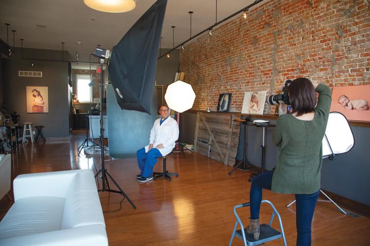 Emmalee Schaumburg working a photo session in her photo studio at 500 Locust Street with Dr. Steve Segebrecht. Photo by Steven Hertzog