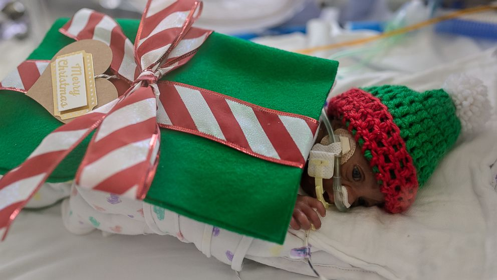 "(Faces You Love Photography/March of Dimes) Santa turned the babies in the NICU at Saint Luke's Hospital of Kansas City into tiny ""gifts"" this holiday season."