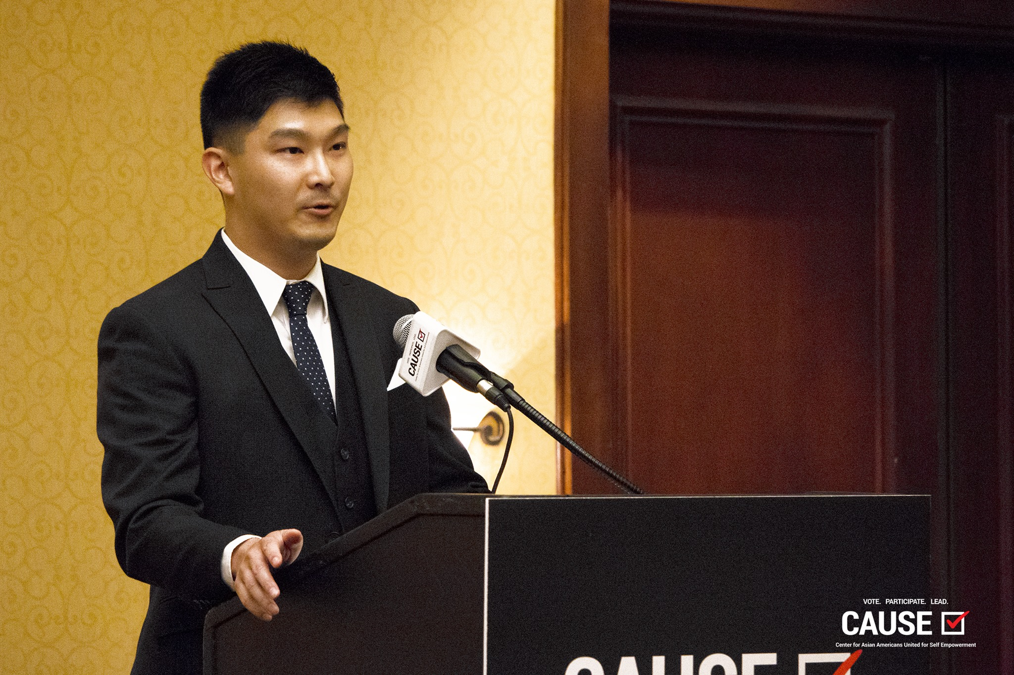 Adam Hsu speaks at the 2018 CAUSE Leadership Institute Graduation