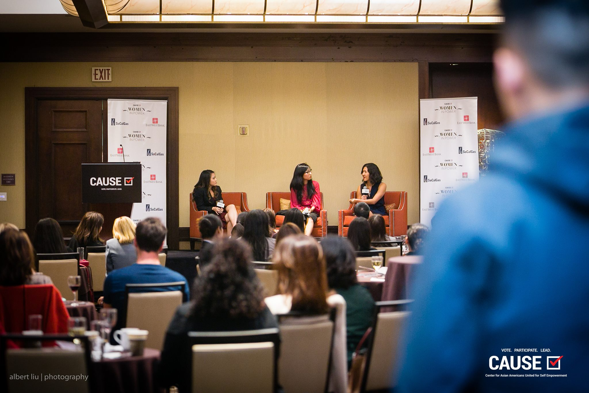"""Kim Yamasaki, Suzy Ryoo, and Tracy Lawrence speaking at the 2018 CAUSE Women in Power """"Leading Through Workplace Patriarchy"""" Networking Reception"""