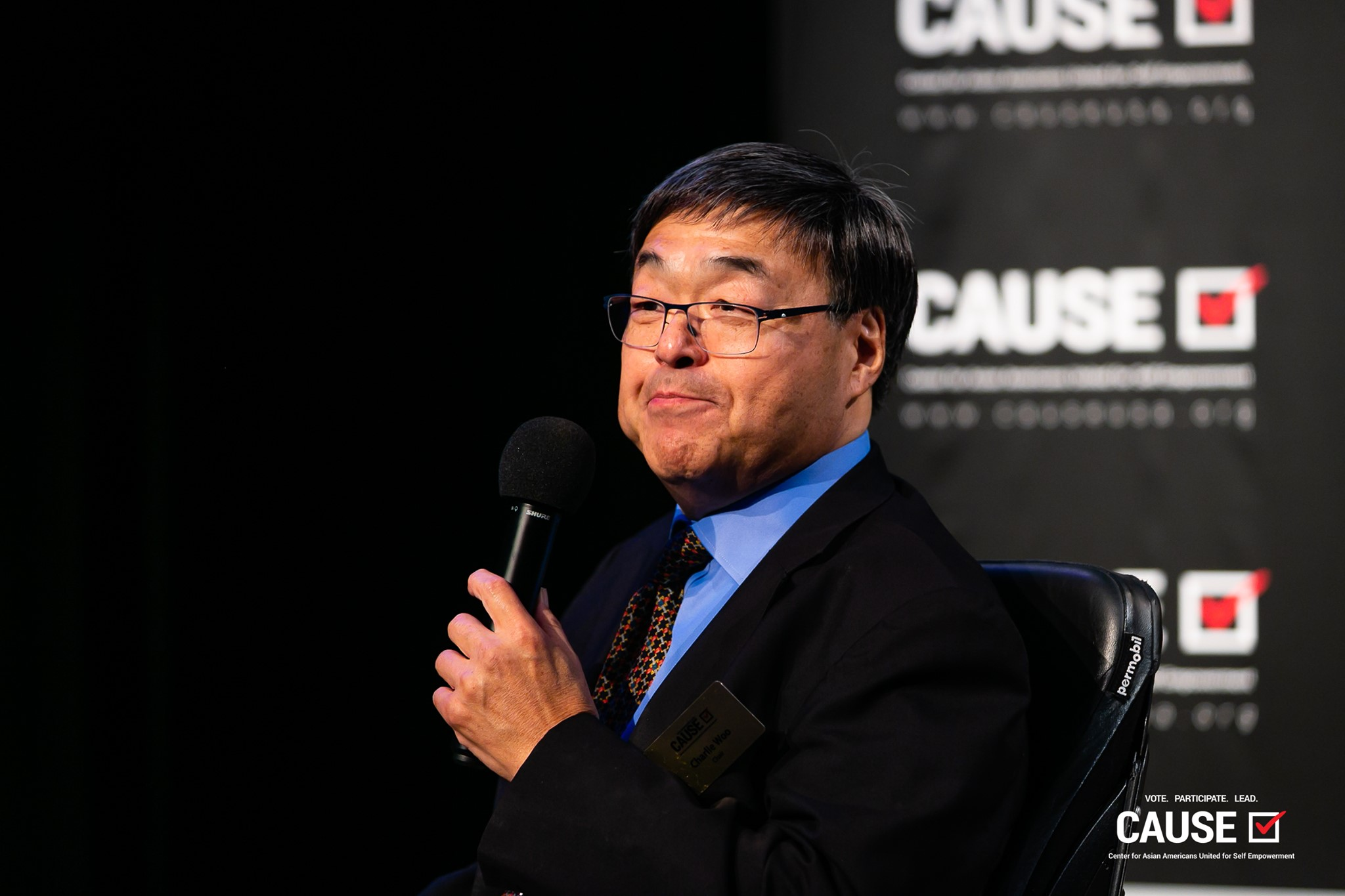 Charlie Woo speaking at the 2019 CAUSE Leadership Academy Graduation