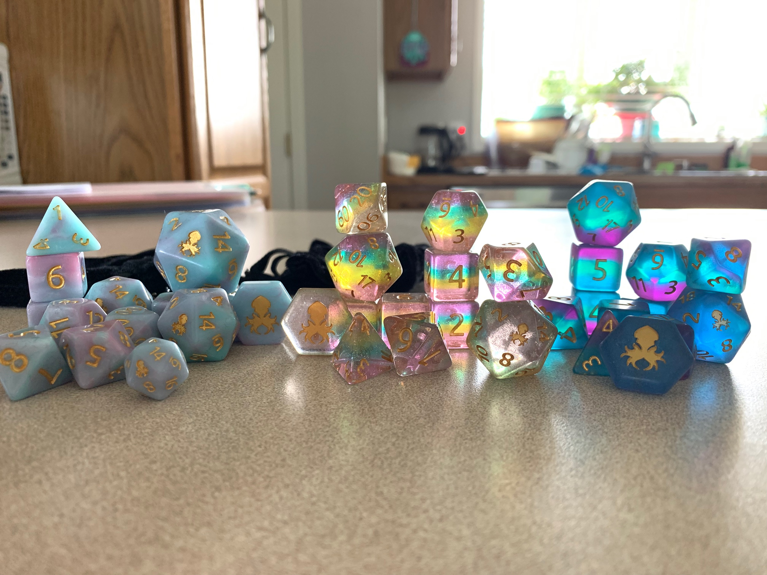 L to R: Cotton Candy I (reissiue with giant D20, mini D20, and D2), Unicorn Tears, Tahiti Twilight Sea Glass (I call them Coulson lol)