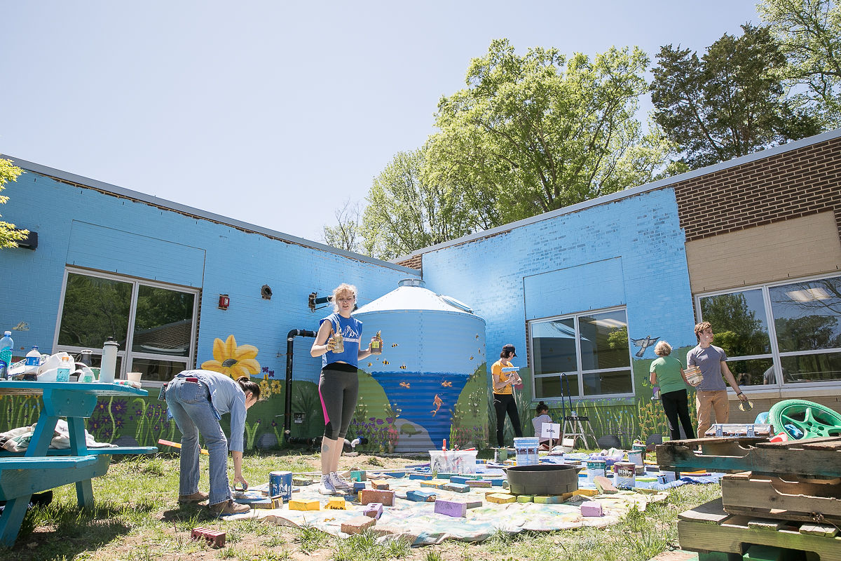 Photography by Jin - All hands on deck painting a 3D mural in the Outdoor Classroom