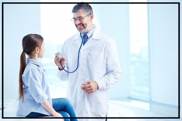 doctor-examining-his-young-patient_1098-2162.jpg