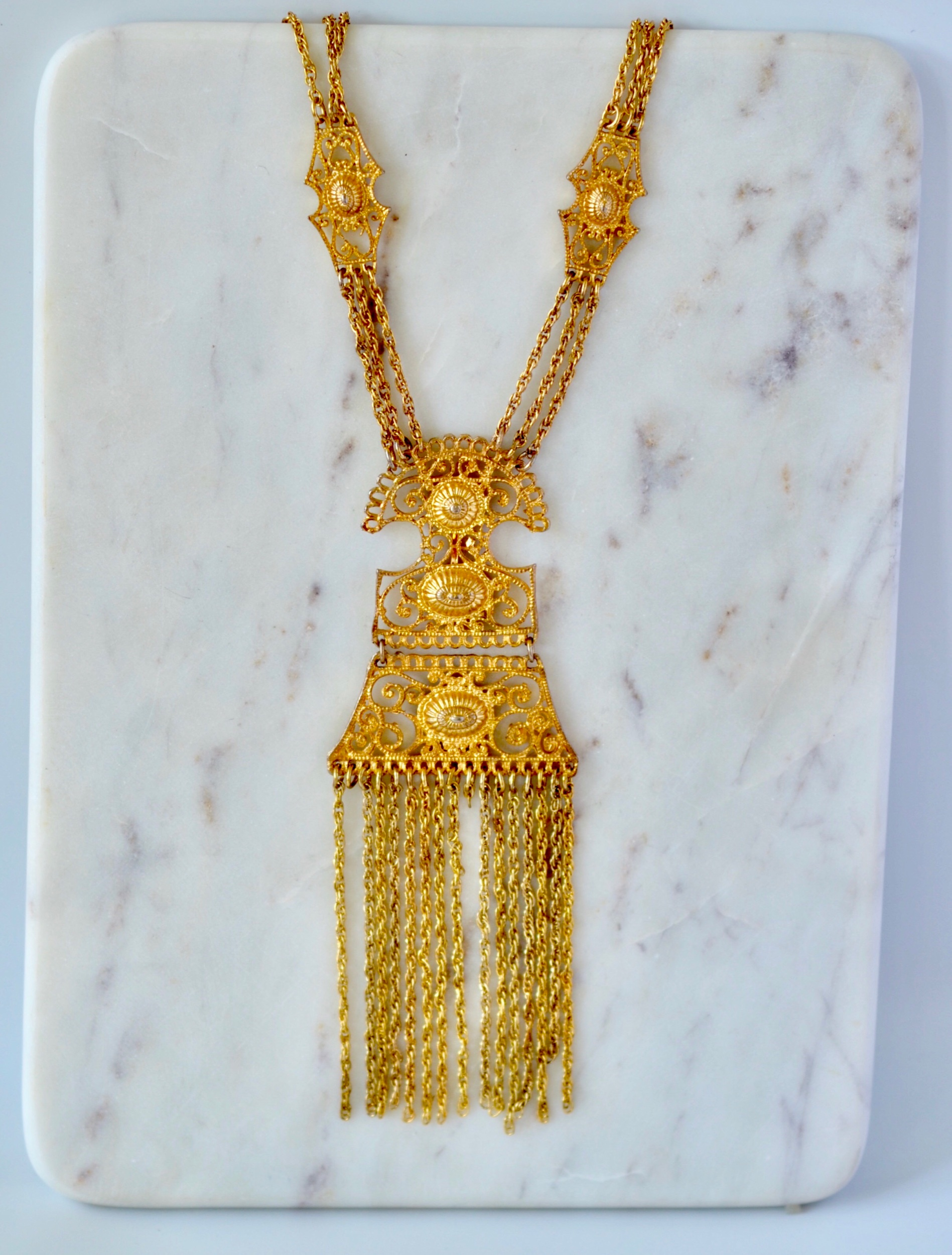 "Gold and Bold: ""a large gold statement piece will definitely put you in the spotlight"" *available in our brick and mortar"