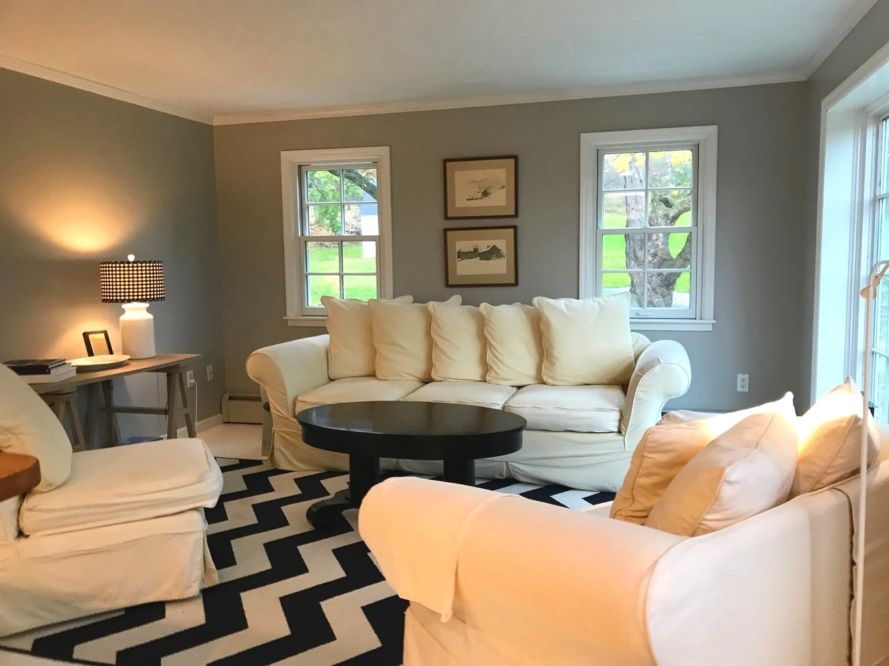 Spacious second floor two-room suite with campus view. king bed, private bathroom with combination shower/tub, living area, and galley kitchen (refrigerator, microwave, dishwasher).