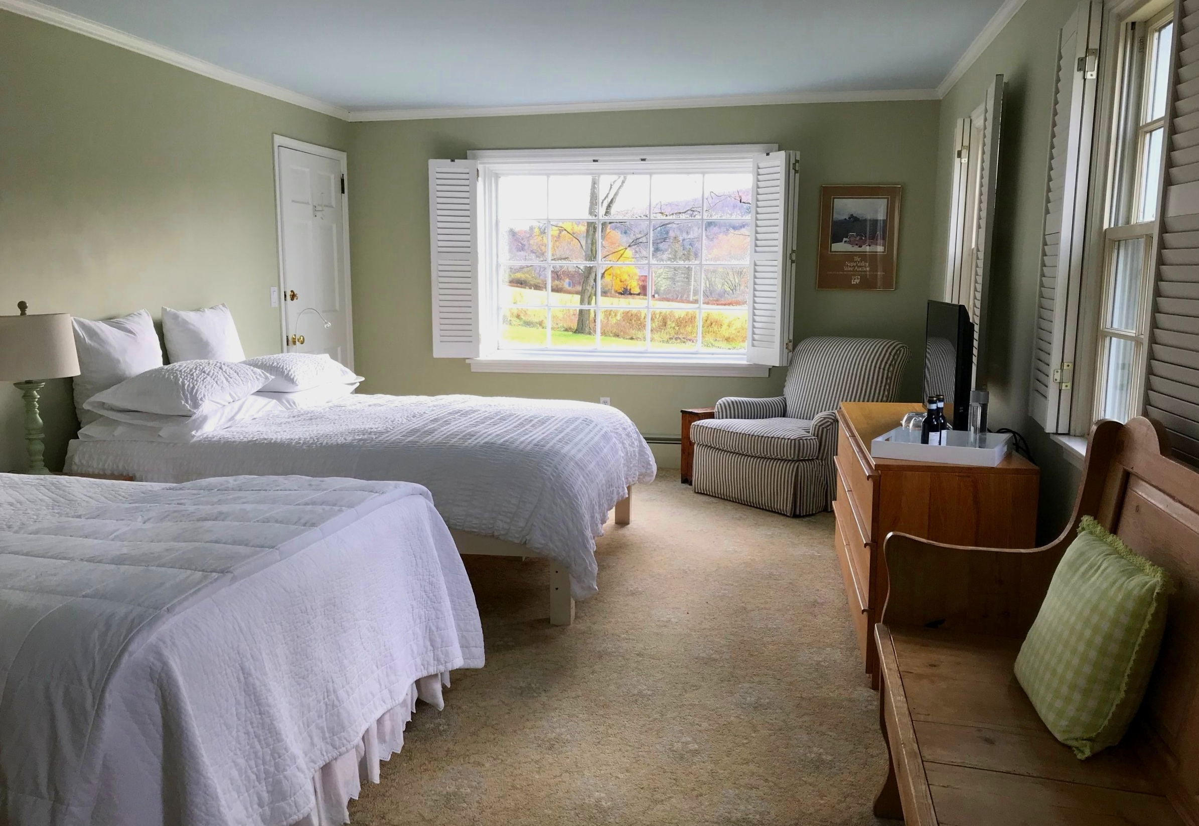 First floor room with queen and full bed, golf course and campus views. Private bathroom with combination shower/tub.