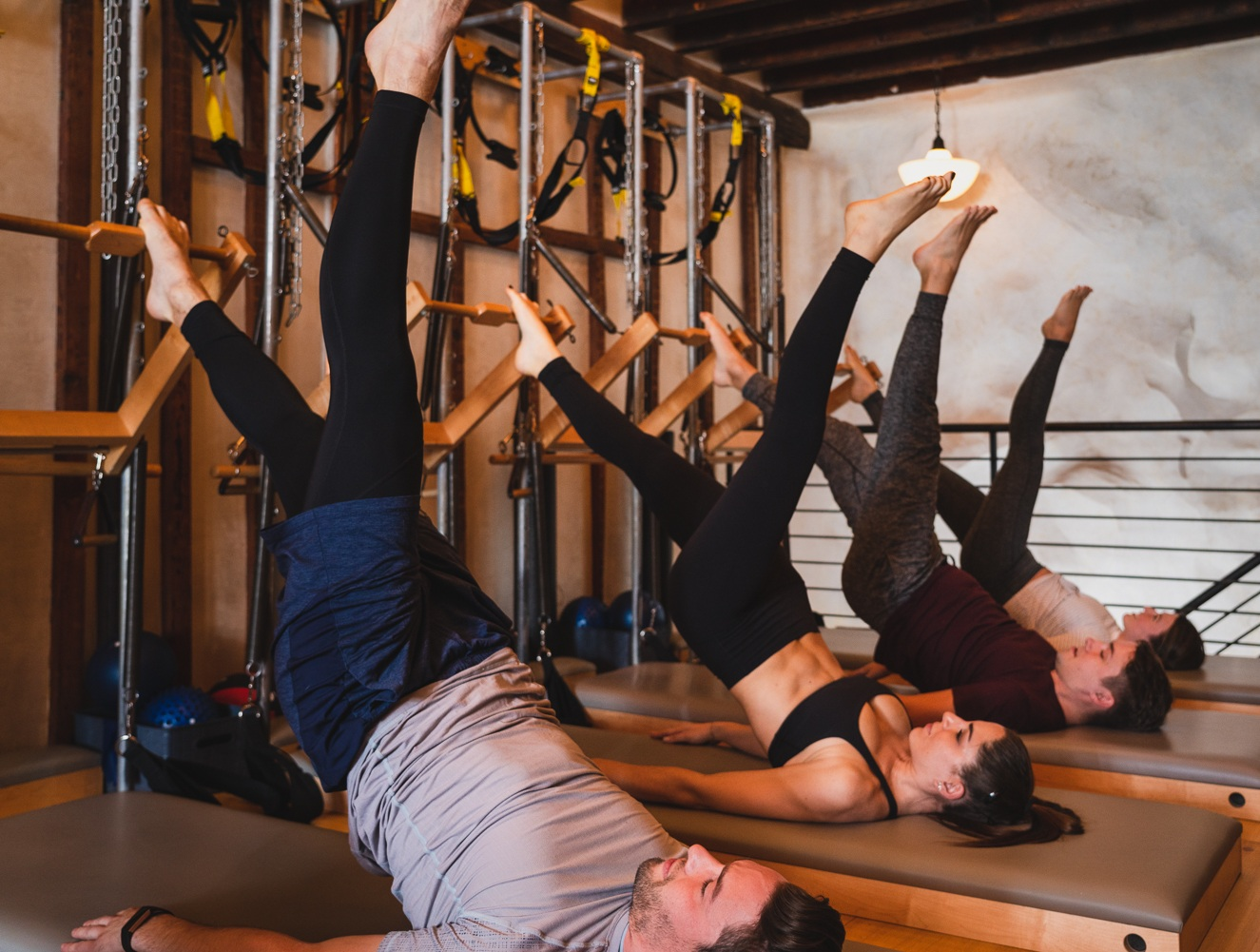 PILATES - Our standard Pilates class helps you develop a long, lean body in a challenging workout. The resistance of the Tower adds intensity to a traditional Pilates routine, producing a sculpted body and strong core. A great complement to your HIIT, Crossfit, or even Yoga training.