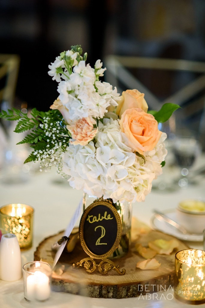 Peach Rustic Wedding at Elm Ridge Golf & Country Club Ile Bizard Montreal Flower Centerpiece on Wooden Slab N+J05.jpg