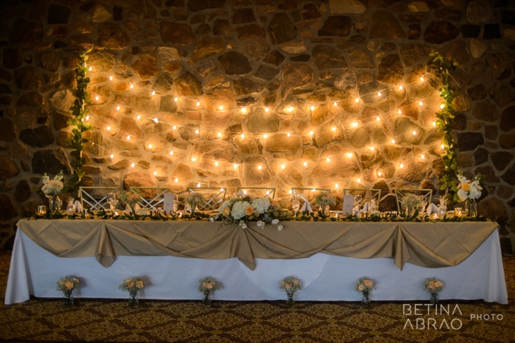 Peach Rustic Wedding at Elm Ridge Golf & Country Club Ile Bizard Montreal Head Table Bistro Lights Backdrop N+J07.jpg
