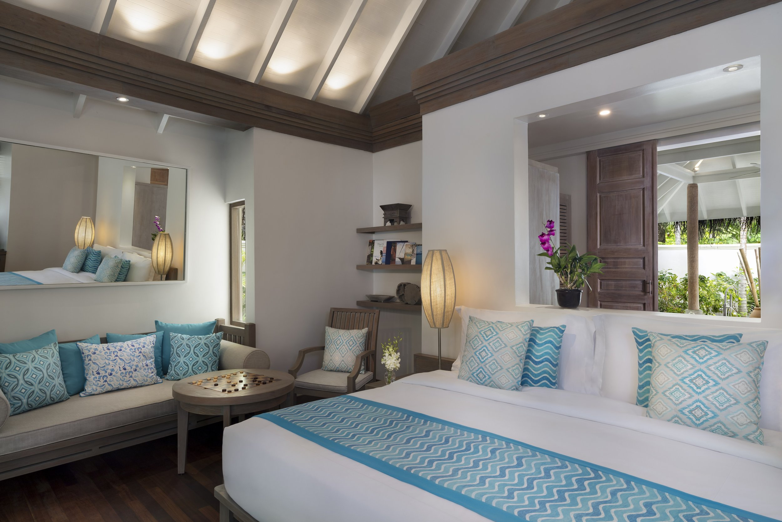 Anantara_Dhigu_Sunset_Beach_Villa_Bedroom_Angle.jpg