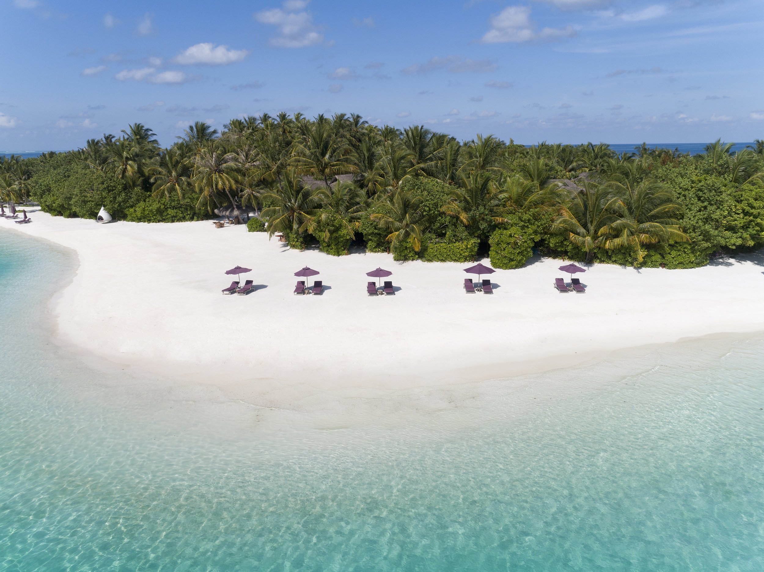 Naladhu_Private_Island_Aerial_Beach_Livingroom.jpg