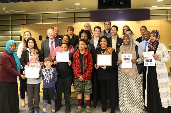 Board members and their children being recognized by the Superintendent and School Board 2018