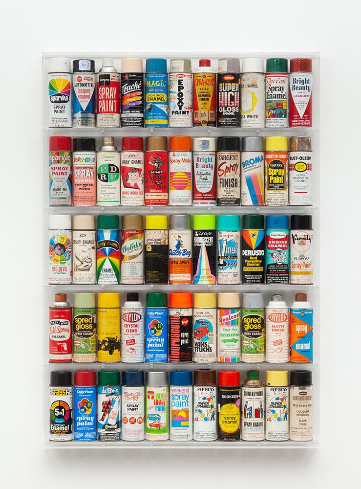 "Freon Wunderkammer , 2018. Pre-barcode spray cans, wood, Plexiglass, 31"" x 44 ½"" x 3 ½""."