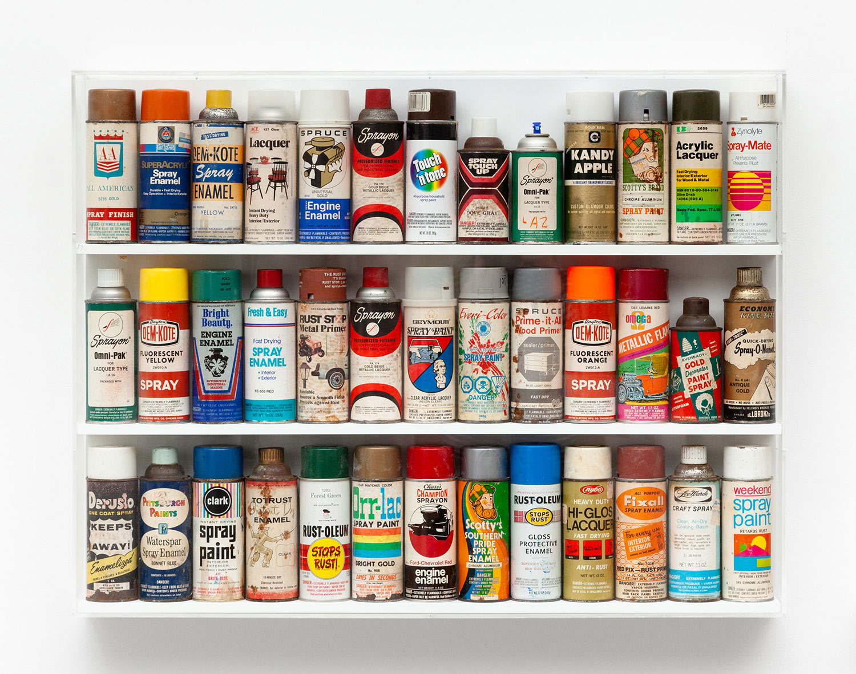 "Freon Wunderkammer,  2018. Pre-barcode spray cans, wood, Plexiglass, 31"" x 44 ½"" x 3 ½""."