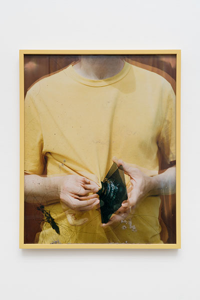 "Lens Cleaning Rodenstock Apo-Sironar 56/135mm, James Perse Medallion Crewneck Jersey T-shirt,  2017, Variation of 4, Chromogenic print and studio dust displayed in frame, 25"" x 20"""