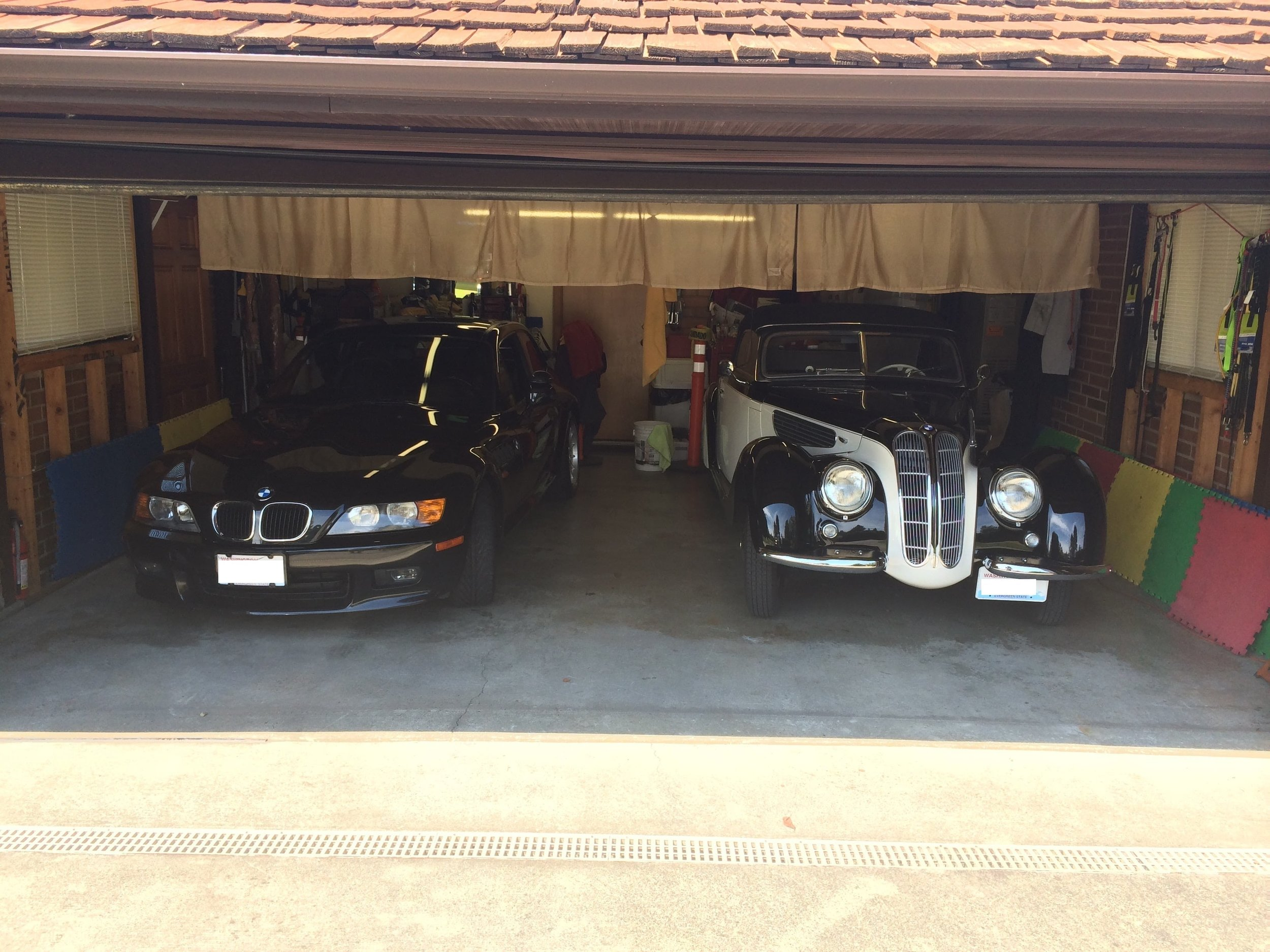 two-vintage-vehicles-auto-detailing-in-garage