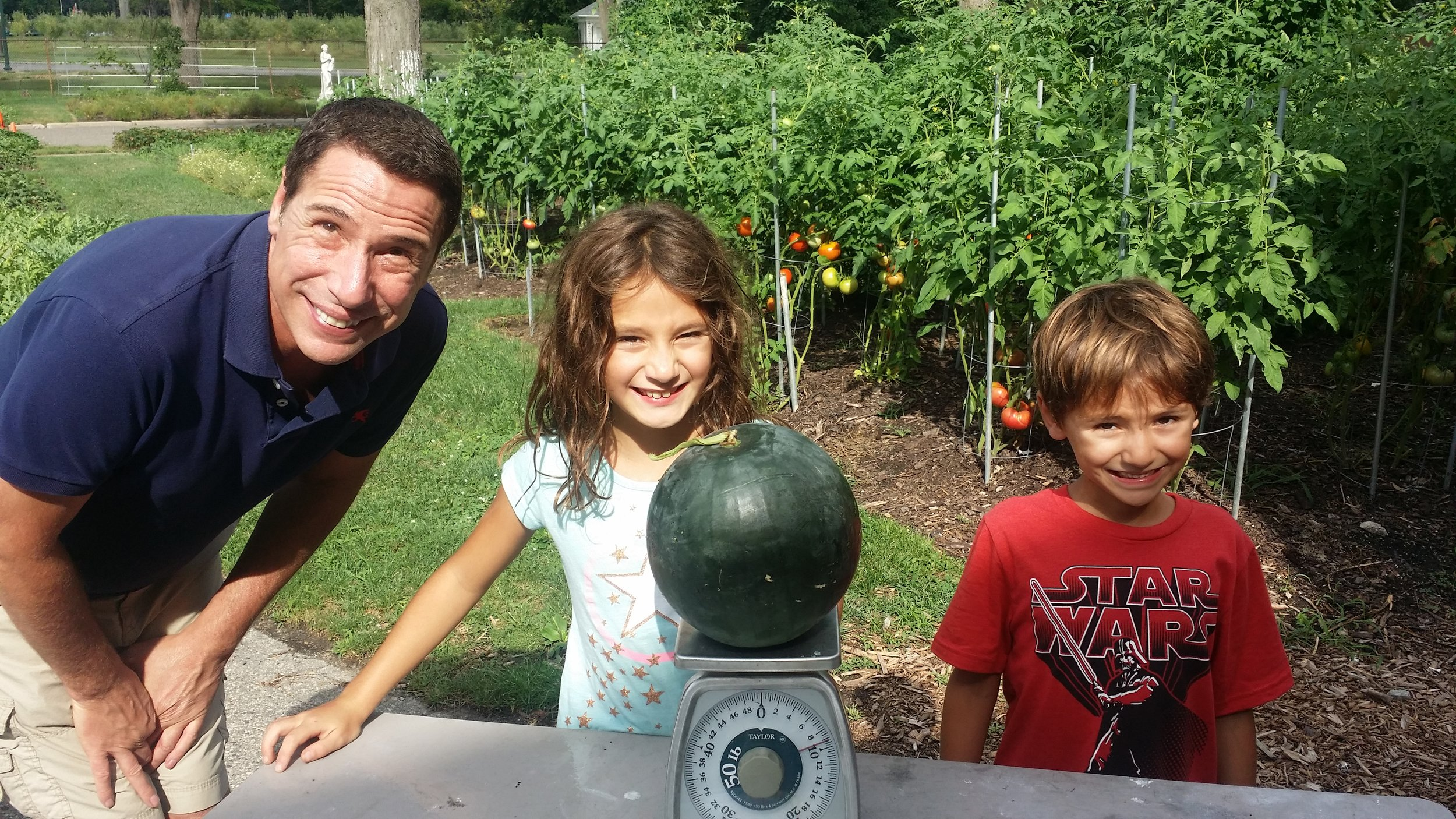 Uncle Bo and the Kids love the watermelons!