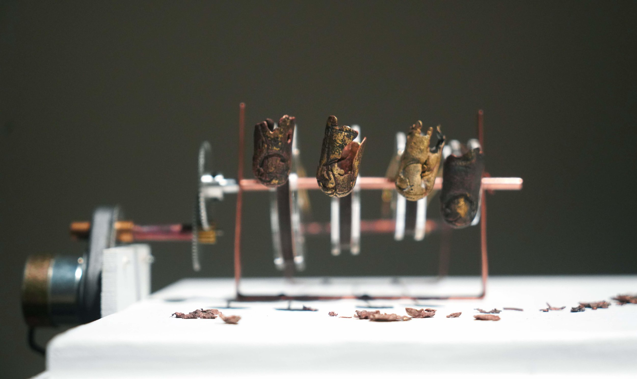 Brass casts of my finger tips. copper, wood, acrylic, clock gears, found miniature screws, found 5rpm motor.