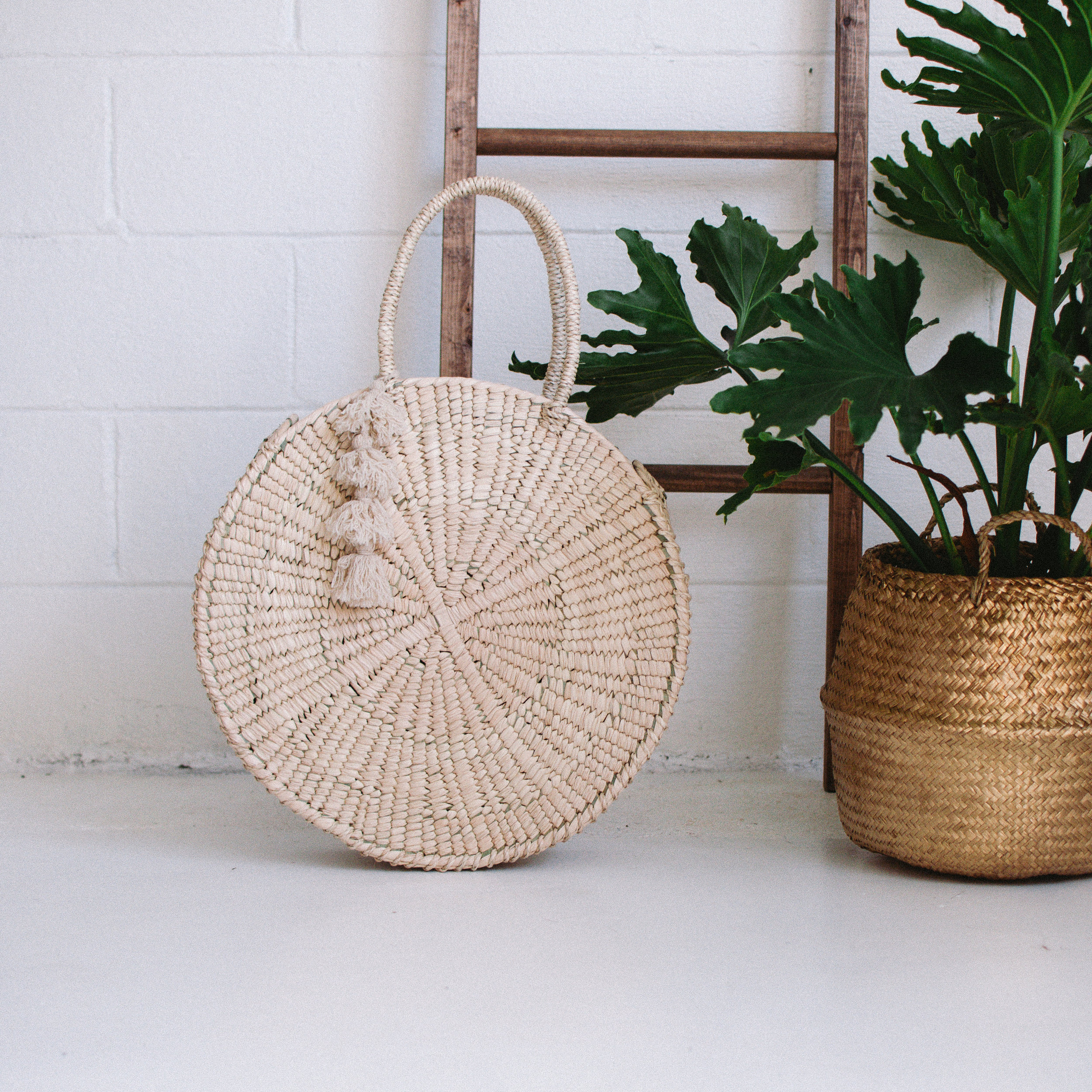 The Moon Tote. Crafted by artisans in Southern Mexico from 100% local palm, this bag - which takes three full days to produce - is truly a work of art.