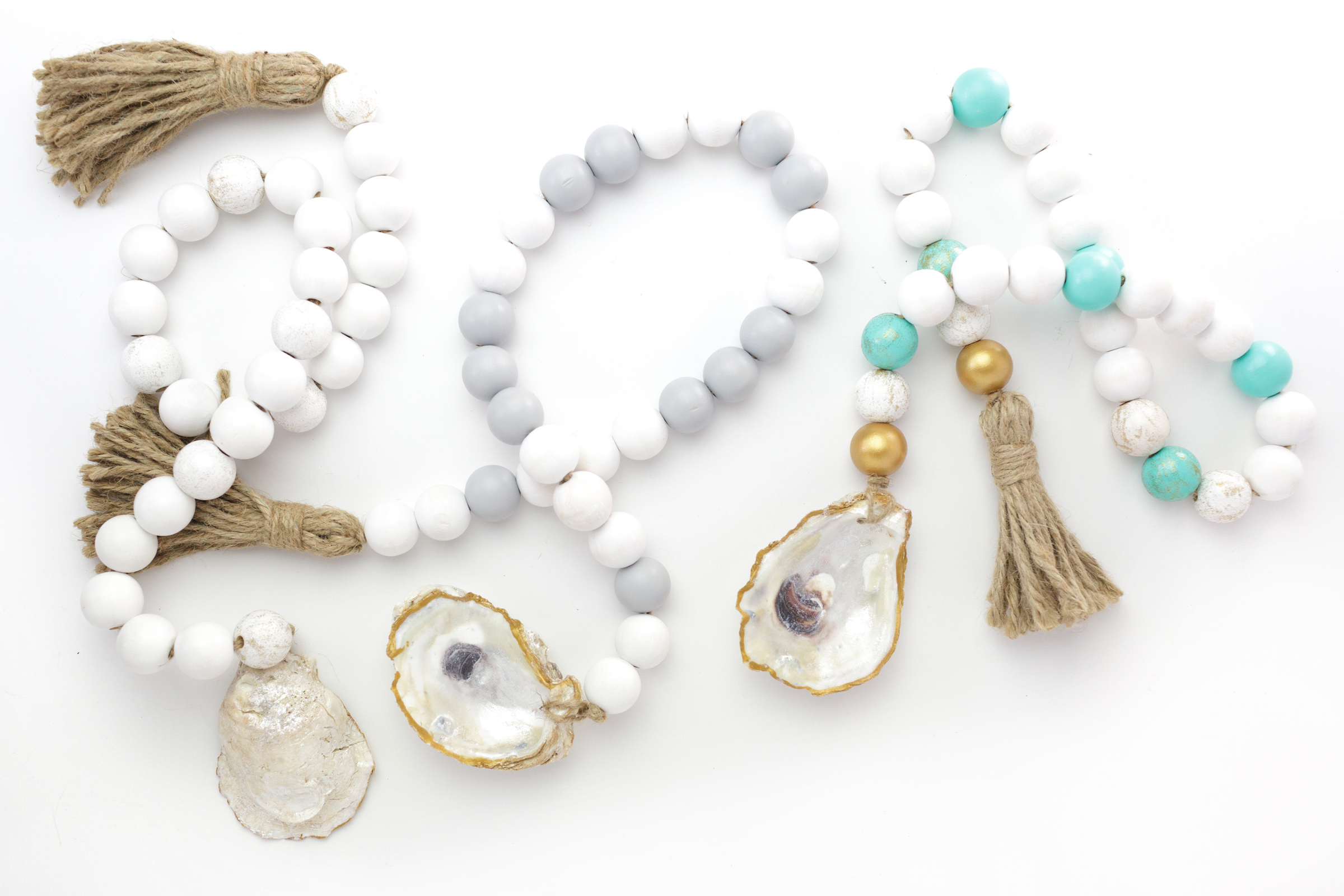 Coastal Garland in white, light grey, and turquoise.