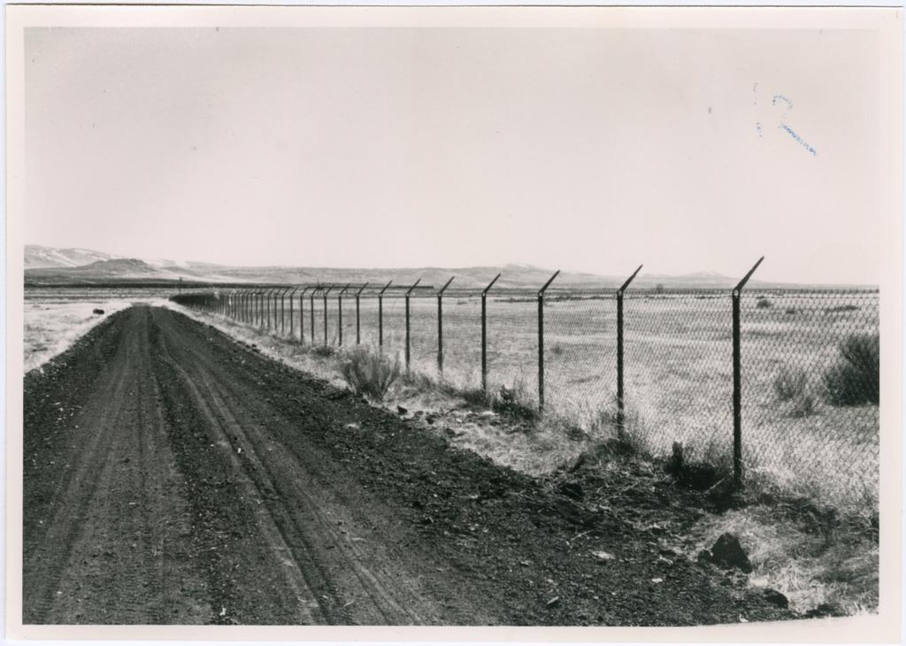 Tule Lake eastern boundary fence. Photo courtesy of Frank Sato Collection