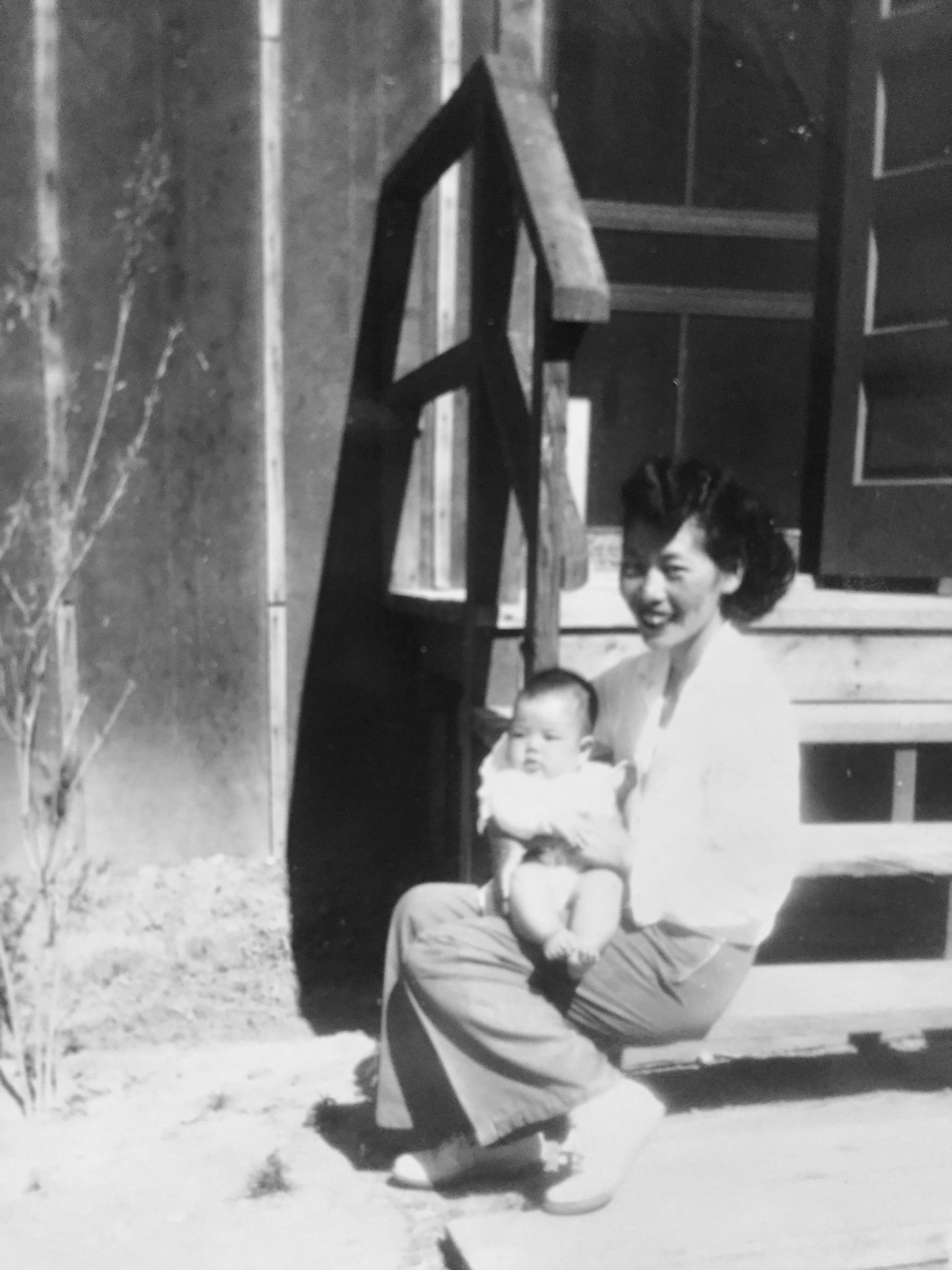 Tommy and her first child, Janice, in Heart Mountain