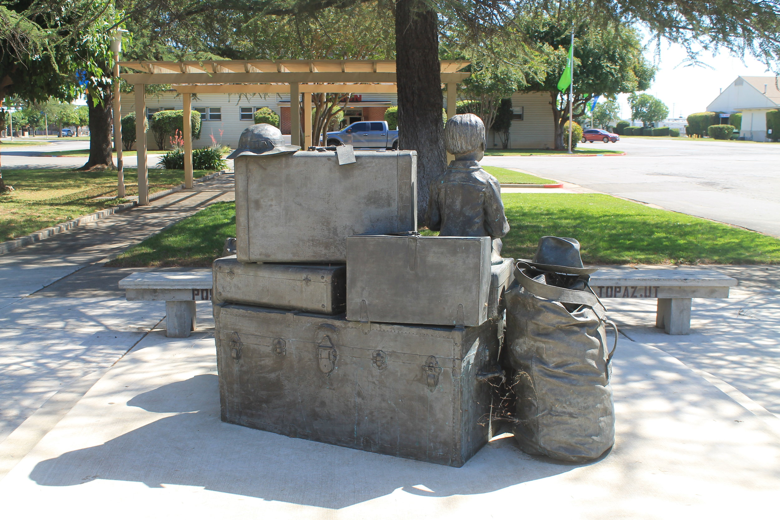 The memorial centerpiece at the Merced County Fairgrounds. The suitcases are all real, casted in bronze.