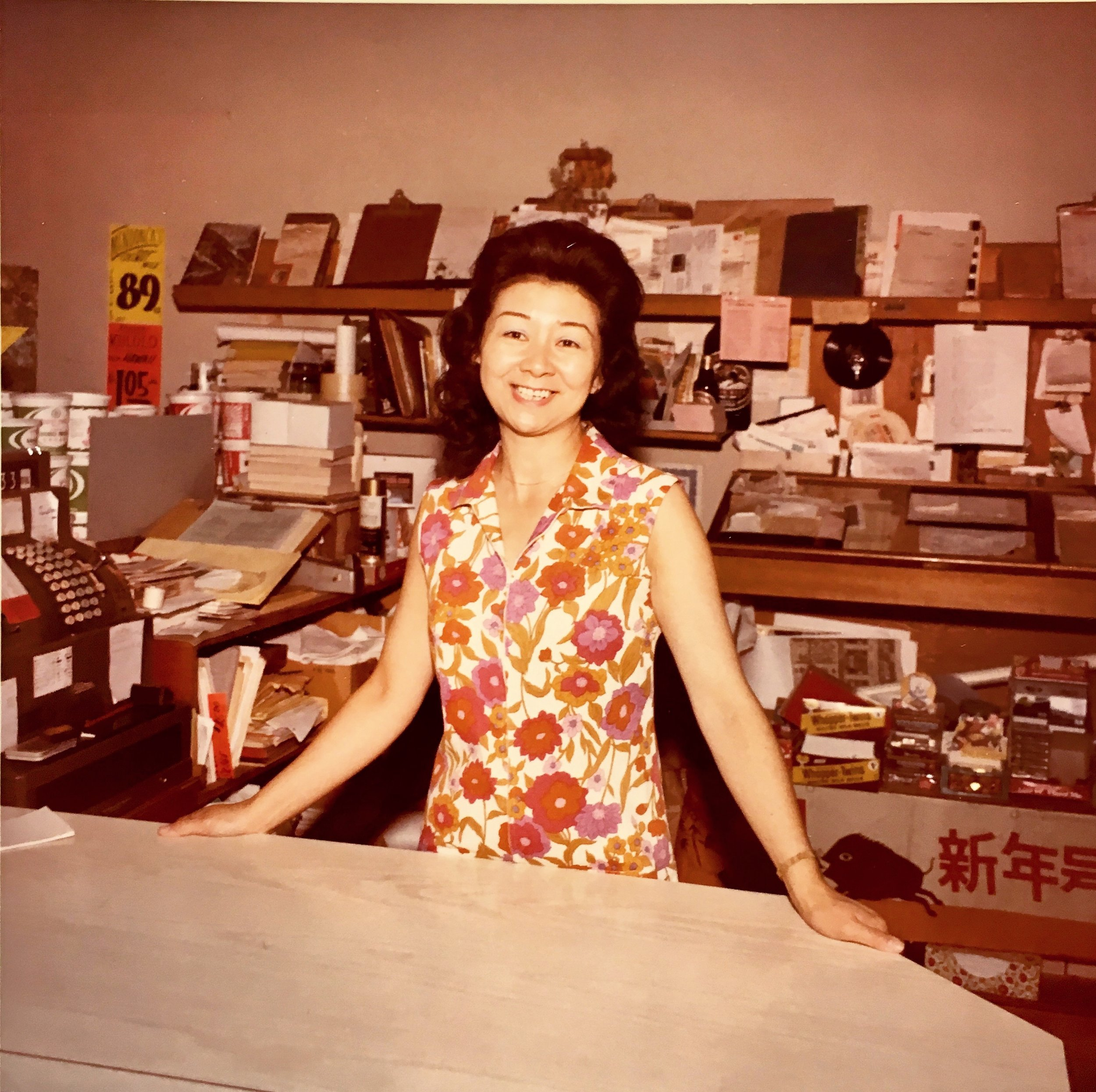 Mary behind the counter of her family business, Shi's Fish Mart