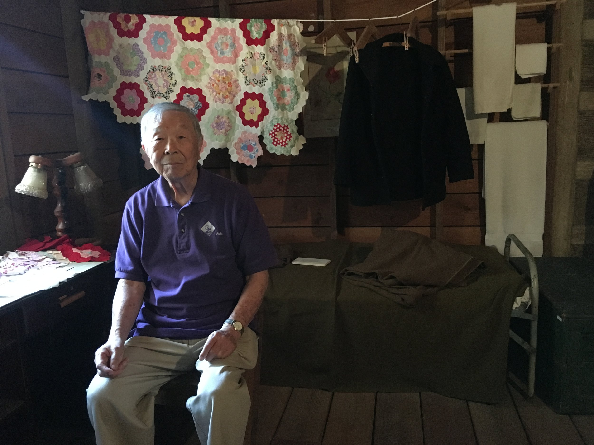 Roy Matsuzaki inside the barrack room replica at the Japanese American Museum of San Jose