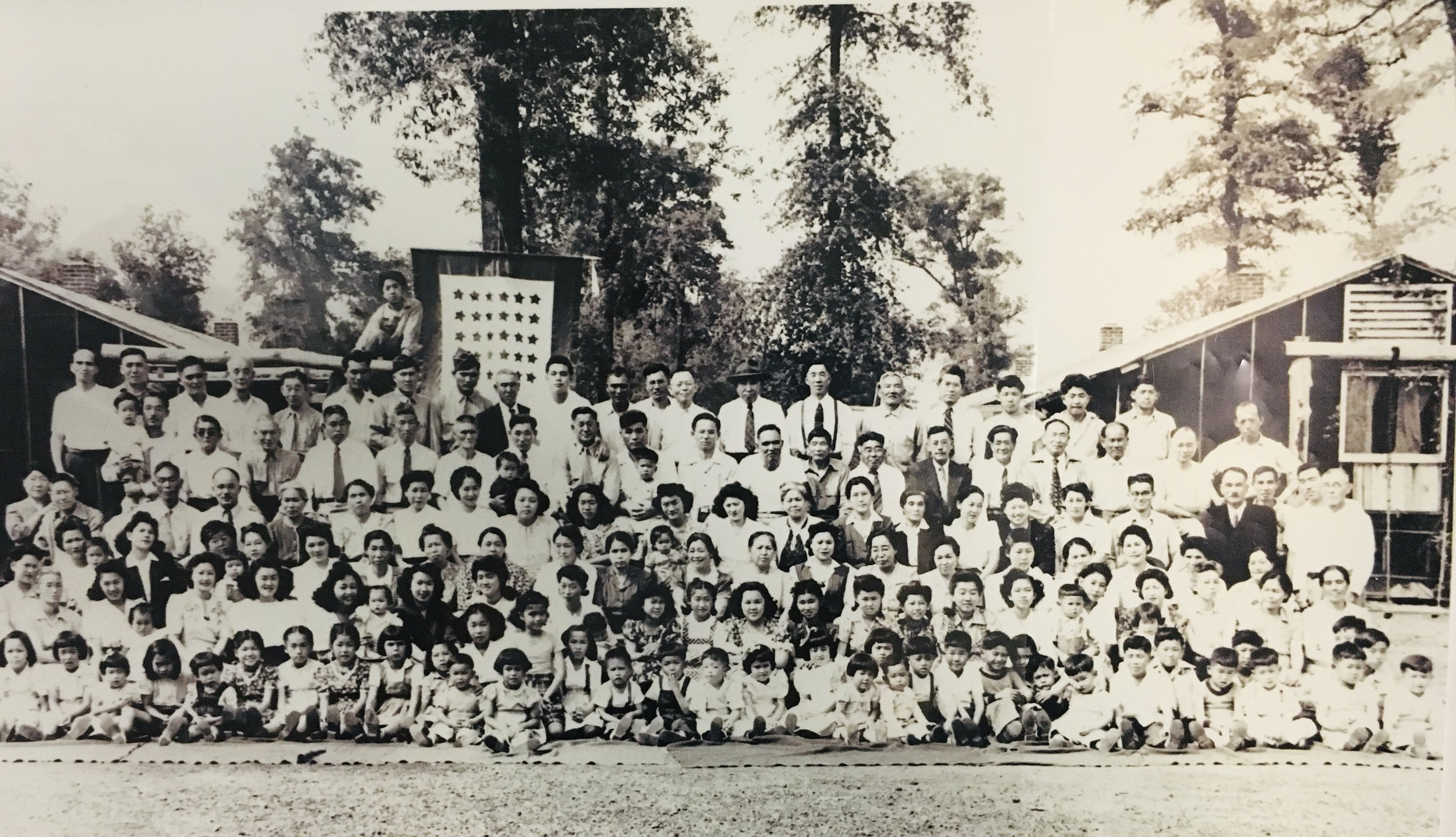 Rohwer Block 7 residents (all were primarily from Los Angeles), including two 442nd RCT soldiers visiting from Camp Shelby (top row, seventh and eighth from left). Roy's whole family is also in this photo. Date: April 15, 1944