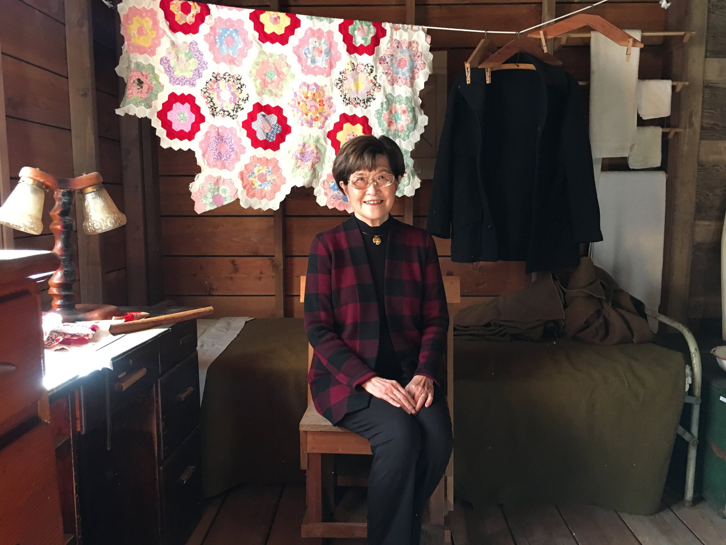 Yoshiko sits in the barracks room at the Japanese American Museum of San Jose