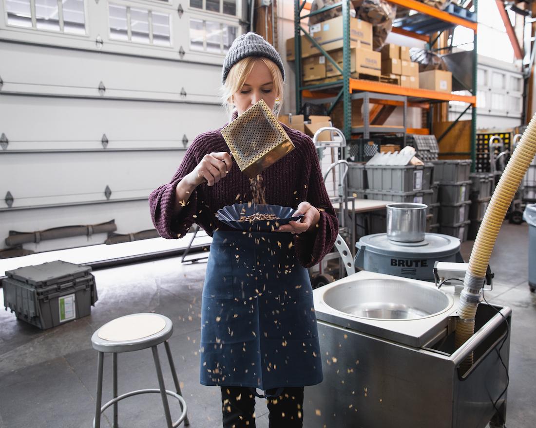 Carly Ahlenius preparing sample roasts of coffee