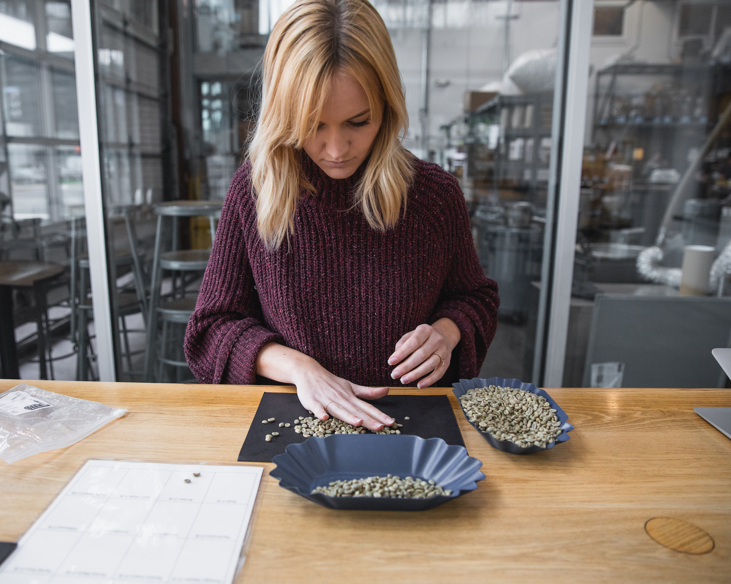 Carly Ahlenius sorting a green coffee sample