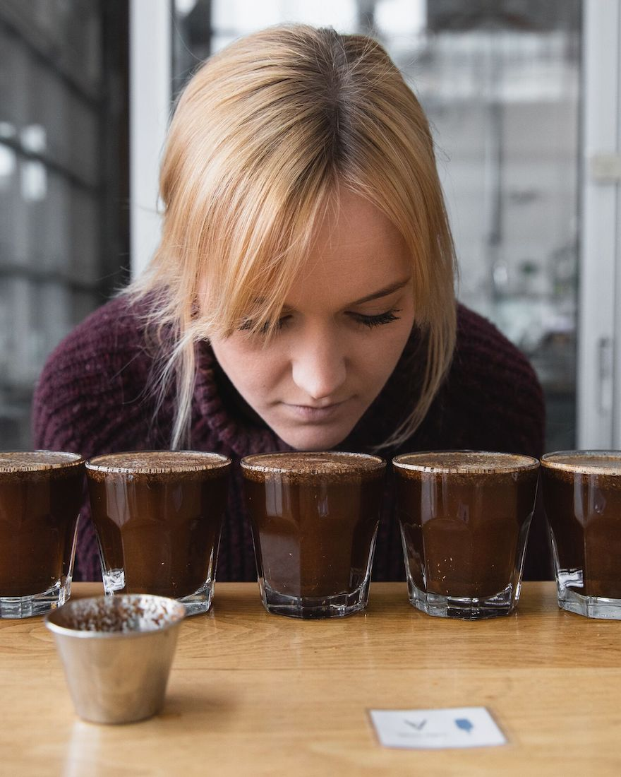 Carly assessing the fragrance of the coffee